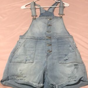 Cute ripped short summer time overalls .